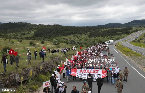 Turkey's main opposition Republican People's Party members walk during a 'walk for justice' from Ankara to Istanbul against the sentencing to 25...