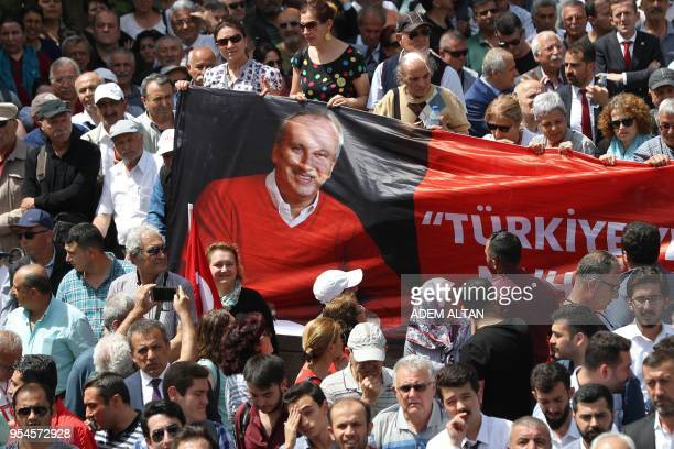 Turkey's main opposition Republican People's Party supporters display a banneras they listen to their candidate for the upcoming snap presidential...