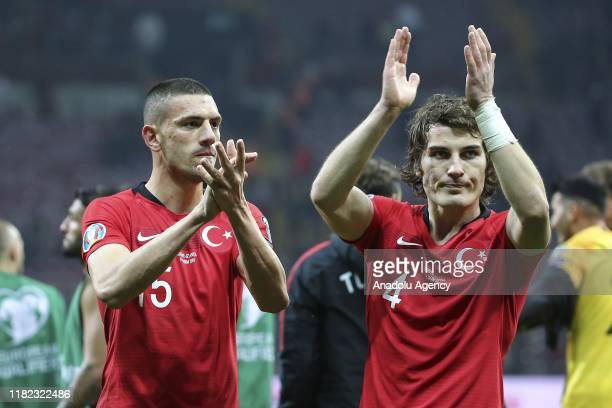 Turkey's Merih Demiral and Caglar Soyuncu celebrate at the end of the UEFA Euro 2020 Qualifiers Group H match between Turkey and Iceland at Turk...