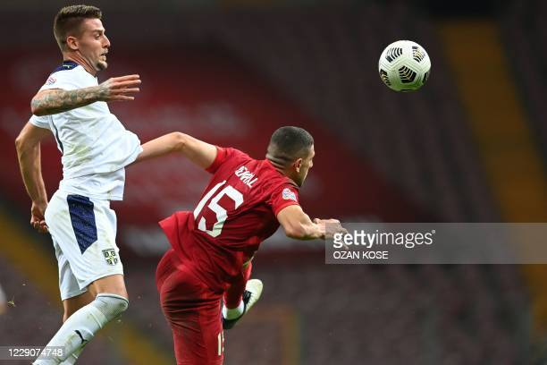 Turkey's Merih Demiral heads the ball next to Serbia's Sergej Milinkovic-Savic during the UEFA Nations LeagueB, group G football match between Turkey...