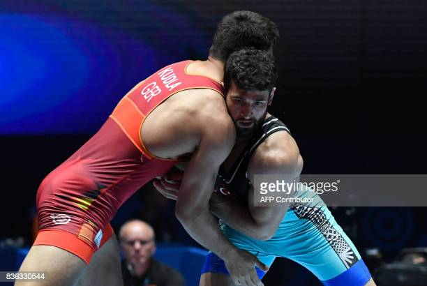 TOPSHOT Turkey's Metehan Basar fights with Germany's Denis Maksymilian Kudla during the men's GrecoRoman style 85 kg category final of the FILA World...