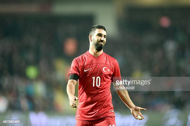 Turkey's midfielder Arda Turan reacts during the Euro 2016 friendly football match between Turkey and Greece at Basaksehir stadium on November 17...