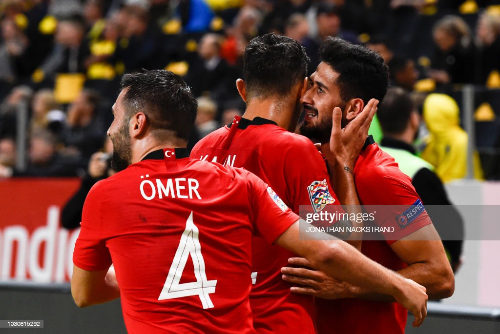 Turkey's midfielder Emre Akbaba celebrates with his teammates after scoring a goal during the UEFA Nations League football match between Sweden and Turkey at the Friends Arena in Solna, on the outskirts of Stockholm, on September 10, 2018.