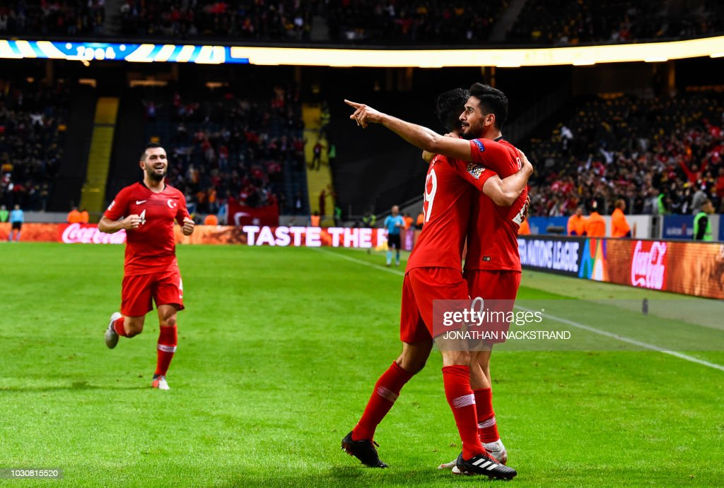 Turkey's midfielder Emre Akbaba (R) celebrates with teammates after scoring a goal during the UEFA Nations League football match between Sweden and Turkey at the Friends Arena in Solna, on the outskirts of Stockholm, on September 10, 2018.