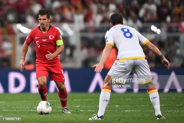 Turkey's midfielder Emre Belozoglu vies with Andorra's midfielder Marcio Vieira during the UEFA Euro 2020 qualifying Group H football match between...