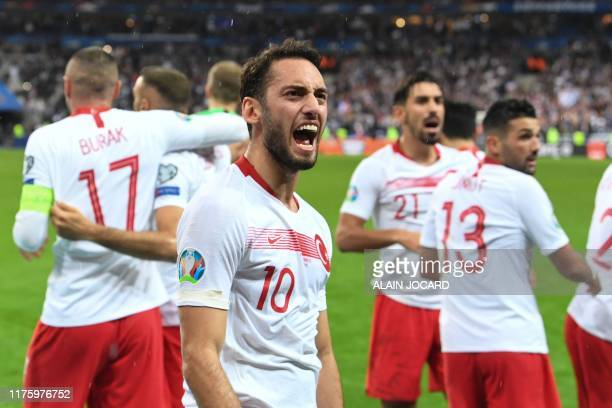 Turkey's midfielder Hakan Calhanoglu and teammates celebrate their equalizer during the Euro 2020 Group H qualification football match between France...