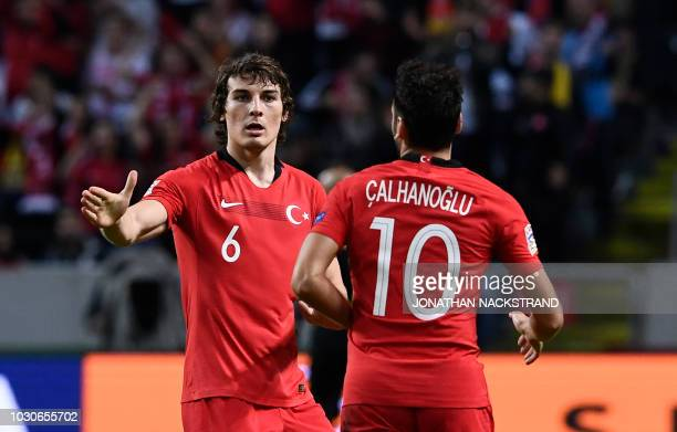 Turkey's midfielder Hakan Calhanoglu celebrates with his teammate Turkey's defender Caglar Soyuncu after scoring during the UEFA Nations League...