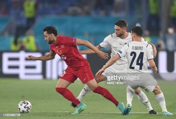 Turkey's midfielder Hakan Calhanoglu, Italy's forward Domenico Berardi and Italy's defender Alessandro Florenzi vie for the ball during the UEFA EURO...