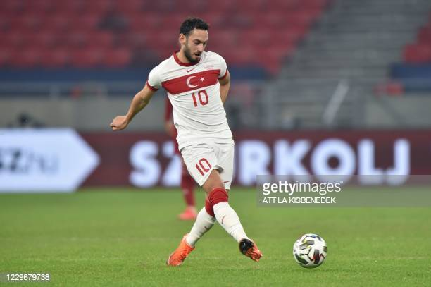 Turkey's midfielder Hakan Calhanoglu plays the ball during the UEFA Nations League Group B football match Hungary v Turkey at the Puskas Arena in...