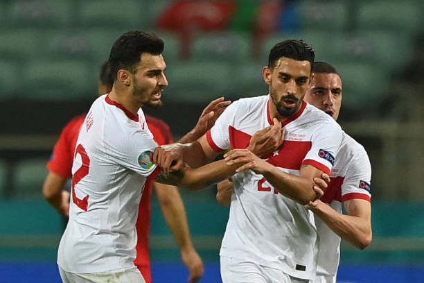 Turkey's midfielder Irfan Can Kahveci celebrates scoring his team's first goal with his teammates during the UEFA EURO 2020 Group A football match...