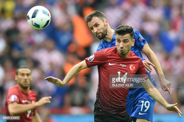 TOPSHOT Turkey's midfielder Oguzhan Ozyakup vies for the ball against Croatia's midfielder Milan Badelj during the Euro 2016 group D football match...