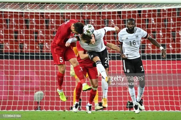 Turkey's midfielder Okay Yokuslu and Germany's defender Robin Koch vie for the ball during the international friendly football match between Germany...