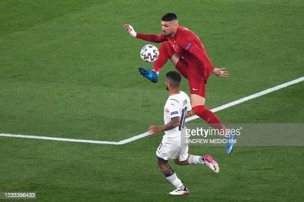Turkey's midfielder Okay Yokuslu vies with Italy's forward Lorenzo Insigne during the UEFA EURO 2020 Group A football match between Turkey and Italy...