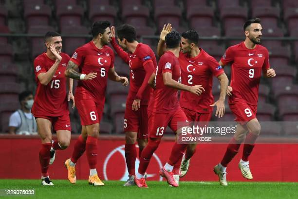 Turkey's midfielder Ozan Tufan celebrates with his teammates after scoring during the UEFA Nations League group B3 football match between Turkey and...