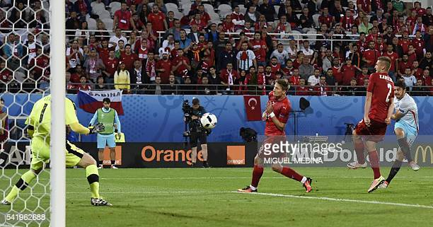 Turkey's midfielder Ozan Tufan scores a goal during the Euro 2016 group D football match between Czech Republic and Turkey at Bollaert-Delelis...
