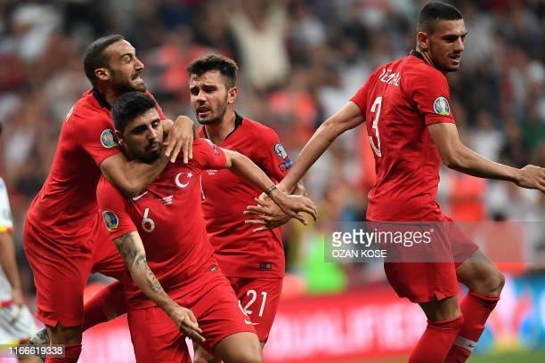 Turkey's midfielder Ozan Turan is congratulated by a teammate after scoring during the UEFA Euro 2020 qualifying Group H football match between...