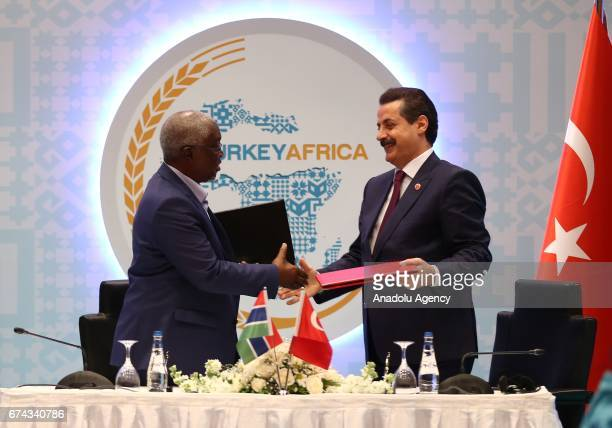 Turkey's Minister of Food Agriculture and Livestock Minister Faruk Celik and Gambian Agriculture Minister Omar Jallow sign a cooperation agreement on...