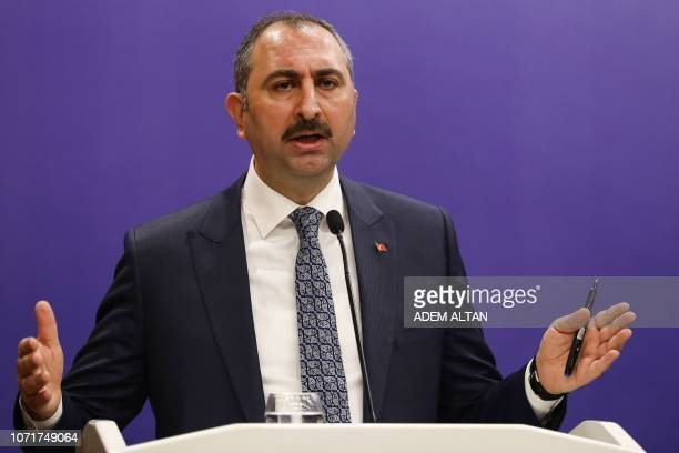 Turkey's Minister of Justice Abdulhamit Gul gestures as he speaks during a joint press conference with Turkey's Foreign Minister Treasury and Finance...