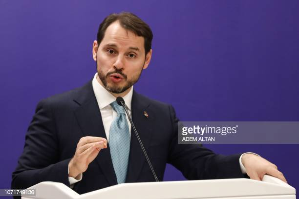 Turkey's minister of Treasury and Finance Berat Albayrak gestures as he speaks during a joint press conference with Turkey's Foreign Minister Justice...