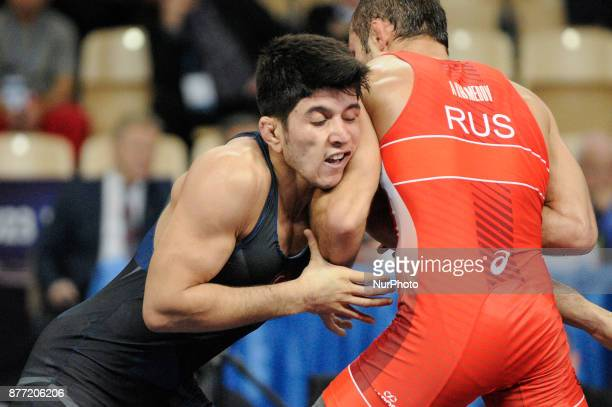 Turkeys Murat Dag competes with Russias Rinat Akhmedov during the Senior U23 Wrestling World Championships in the 71kg class on November 21 2017