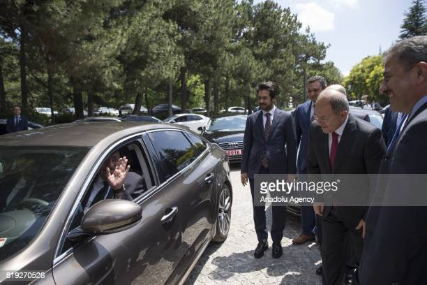 Turkey's new Deputy Prime Minister Recep Akdag bids farewell to former Turkish Deputy Prime Minister Tugrul Turkes after a handover ceremony...