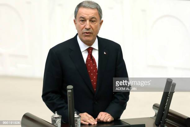 Turkey's newly appointed National Defence Minister Hulusi Akar swears in at the Grand National Assembly of Turkey in Ankara Turkey on July 10 2018