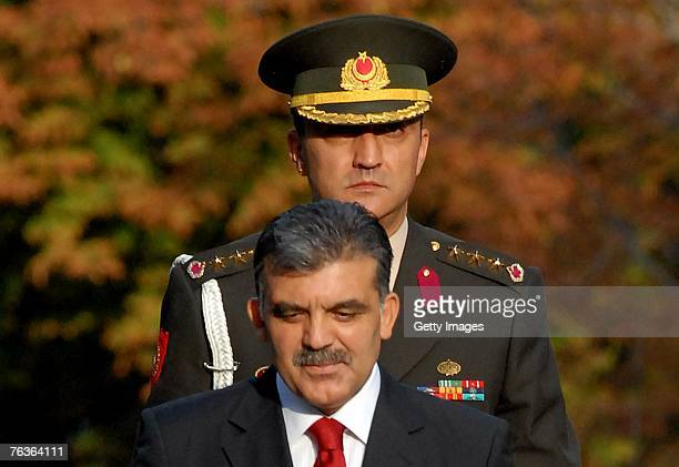 Turkey's newly elected President Abdullah Gul accompanied by presidential aidedecamp reviews the presidential honour guard as he arrives to take the...