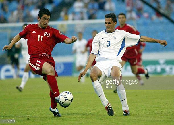 Turkey's Nihat Kahveci and Slovakia's Petras fight for the ball during their Euro 2004 qualifier at the Slovan Bratislava stadium in Slovakia 07 June...
