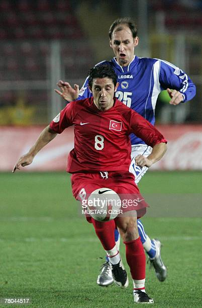 Turkey's Nihat Kahveci is challenged for the ball by Bosnia's Elvis Rahimic during their UEFA Euro 2008 qualifying football match at the Ali Sami Yen...