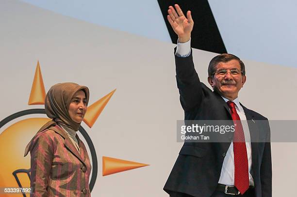 Turkey's outgoing Prime Minister Ahmet Davutoglu and his wife Sare Davutoglu waves to the supporters during the Extraordinary Congress of the ruling...