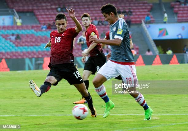 Turkey's player Abdussamed Karnucu duels for the ball against Paraguay's Blas Armoa during the FIFA U17 World Cup match between Turkey and Paraguay...