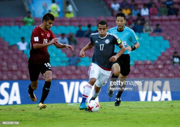 Turkey's player Abdussamed Karnucu duels for the ball against Paraguay's Femando Cardozo during the FIFA U17 World Cup match between Turkey and...