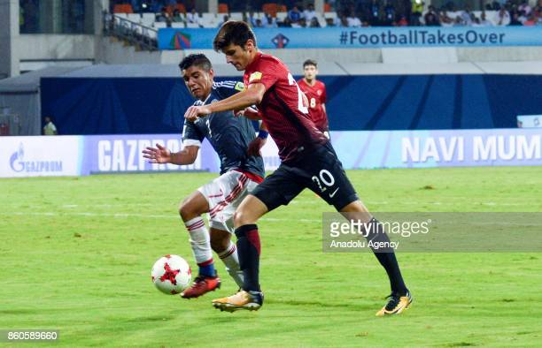 Turkey's player Embiya Ayyildiz duels for the ball against Paraguay's Antonio Galeno during the FIFA U17 World Cup match between Turkey and Paraguay...