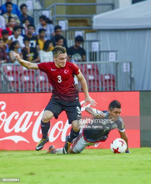 Turkey's player Melih Gokcimen duels for the ball against Paraguay's Antonio Galeano during the FIFA U17 World Cup match between Turkey and Paraguay...