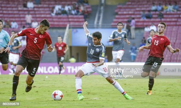 Turkey's player Ozan Kabak duels for the ball against Paraguay's Blas Armoa during the FIFA U17 World Cup match in Mumbai India Thursday Oct 12 2017