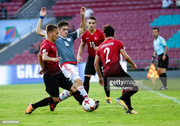 Turkey's player Sefa Akgun duels for the ball against Paraguay's Anibal Vega during the FIFA U17 World Cup match between Turkey and Paraguay in...