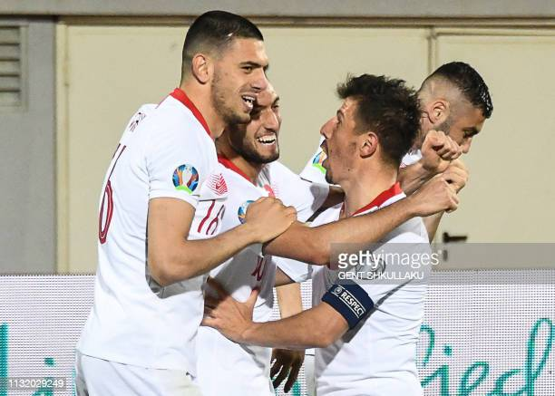 Turkey's players celebrate after scoring a goal during the Euro 2020 Group H qualification football match between Albania and Turkey at the Loro...