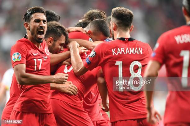Turkey's players celebrate after scoring during the UEFA Euro 2020 qualifying Group H football match between Turkey and Andorra at the Vodafone Park...