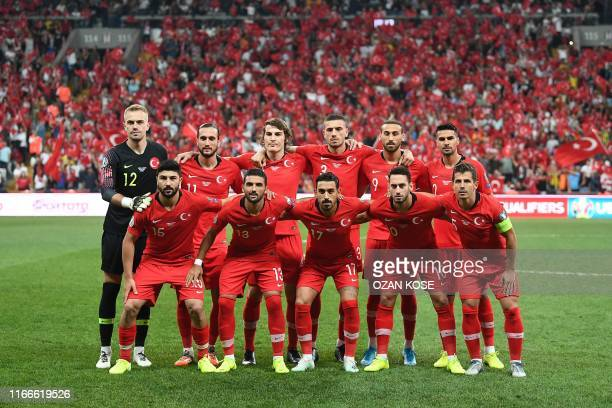 Turkey's players line up before the UEFA Euro 2020 qualifying Group H football match between Turkey and Andorra at the Vodafone Park Stadium in...