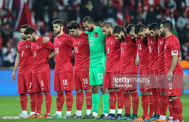 Turkey's players observe a minute of silence to honour the victims of the Paris attacks prior to an international friendly soccer match against...