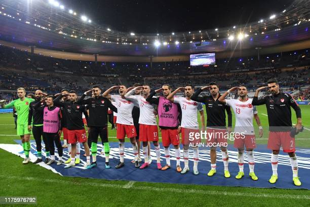 Turkey's players salute at the end of the Euro 2020 Group H qualification football match between France and Turkey at the Stade de France in...