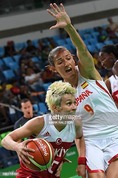 Turkey's point guard Isil Alben works around Spain's point guard Laia Palau during a Women's quarterfinal basketball match between Spain and Turkey...