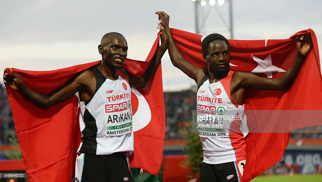 Turkey's Polat Kemboi Arikan (L) and Ali Kaya (R) celebrate after the men's 10,000 final race during the European Athletics Championships in Amsterdam at the Olympic Stadium on July 8, 2016. / AFP / JOHN