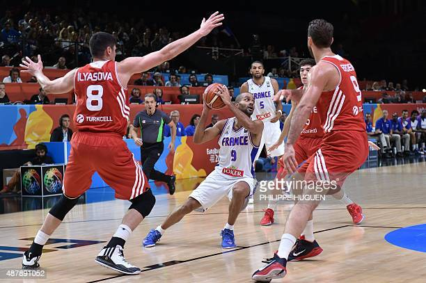 Turkey's power forward Ersan Ilyasova and Turkey's center Semih Erden defends against France's point guard Tony Parker during the round of 16...