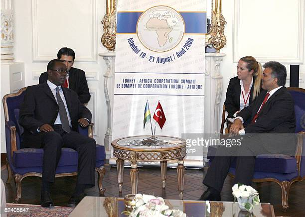 Turkey's President Abdullah Gul confers with Rwandan Prime Minister Bernard Makuza during the TurkeyAfrica Cooperation Summit in Istanbul on August...