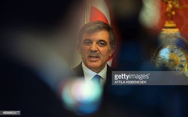 Turkey's President Abdullah Gul gives a statement with his Hungarian counterpart in the presidental palace in Budapest on February 17 2014 during...