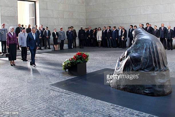 Turkey's President Abdullah Gul lays down a wreath as his wife Hayrunnisa and Guenter Weiler deputy inspector general of the German armed forces...