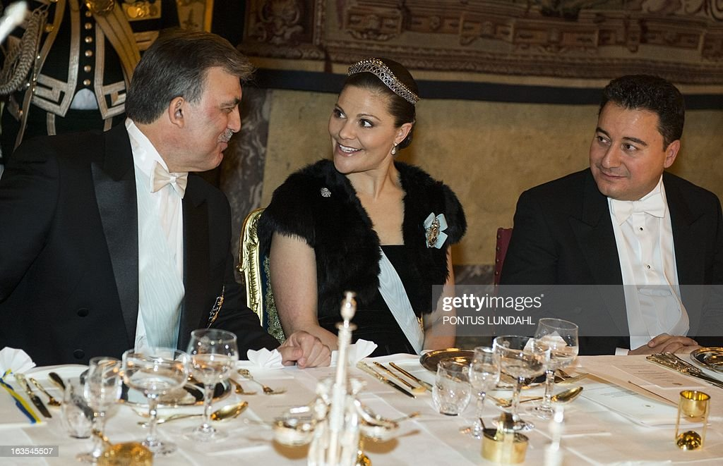 Turkey's President Abdullah Gul (L), Sweden's Crown Princess Victoria (C) and Turkey's Deputy Prime Minister Ali Babacan (R) talk ahead of a gala dinner at the Stockholm Palace on March 11, 2013. Turkey's President Abdullah Gul is on a three day official visit to Sweden.
