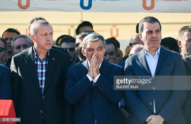 Turkey's President Recep Tayyip Erdogan and former Turkish president Abdullah Gul react after attending the funeral of a victim of the coup attempt...