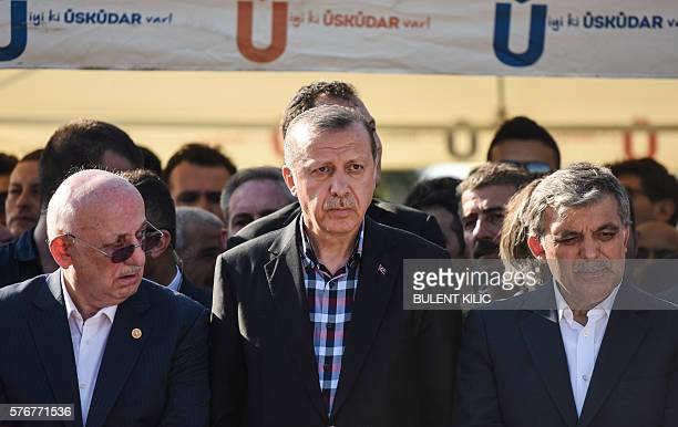 Turkey's President Recep Tayyip Erdogan and former Turkish president Abdullah Gul look on after attending the funeral of a victim of the coup attempt...